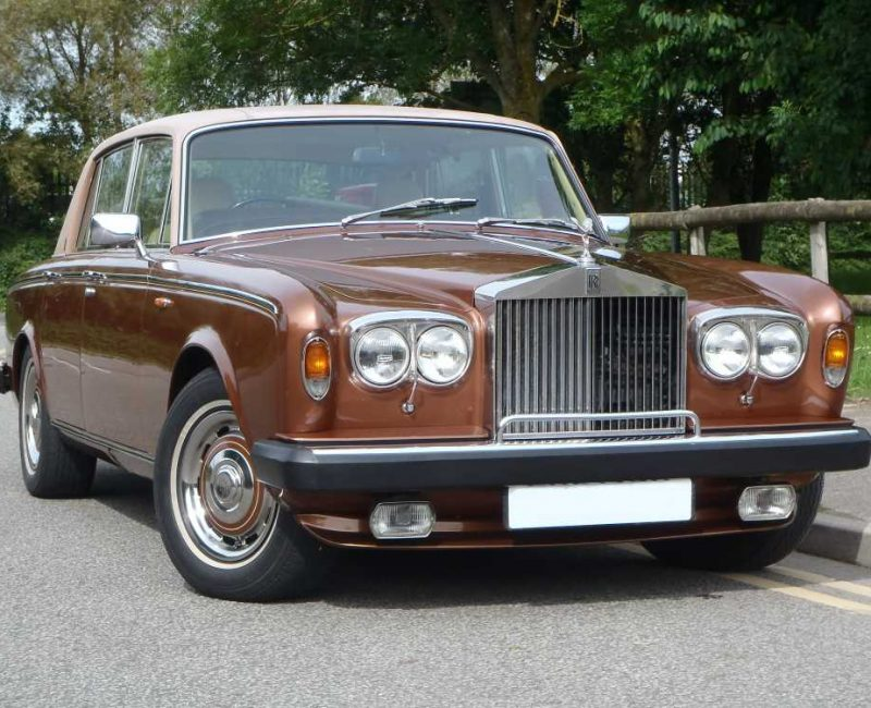 brown rolls-royce car